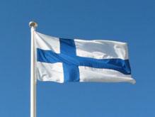 Finnische-Flagge: Das Blaue des Kreuzes steht für die finnischen Seen, die weiße Grundfläche für den Schnee, Quelle: http://de.wikipedia.org/wiki/Flagge_Finnlands